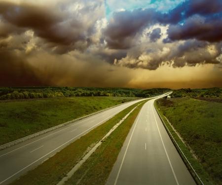 Photo pour Beautiful view on the road under sky with clouds - image libre de droit