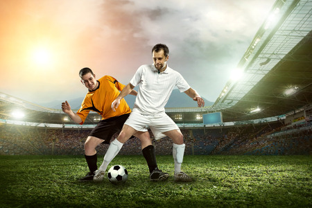 Foto de Soccer player with ball in action outdoors. - Imagen libre de derechos