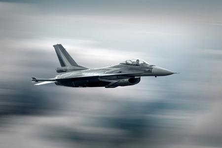 Foto de Military airplane at flying on the speed - Imagen libre de derechos