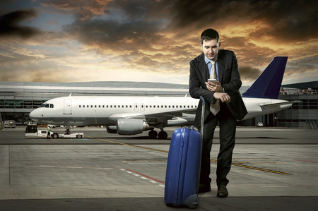 Photo pour Businessman with baggage in airport - image libre de droit