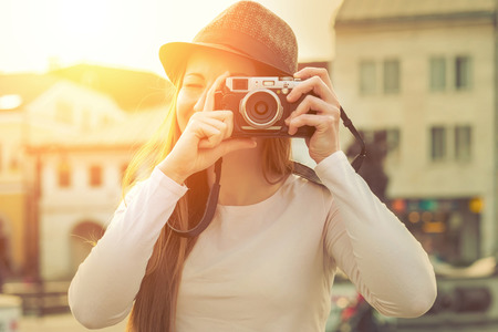Photo for Tourist with photo camera shooting on the street - Royalty Free Image