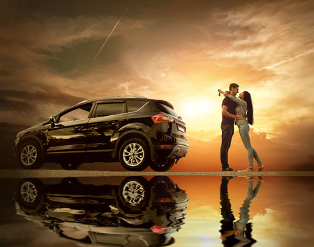 Foto de Happiness couple stay near the new car under sky with reflex - Imagen libre de derechos