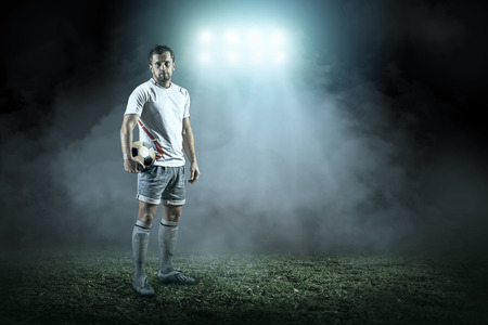 Photo pour Soccer player with ball in action outdoors - image libre de droit