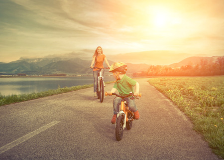 Photo for Happiness Mother and son on the bicycles funning outdoor - Royalty Free Image