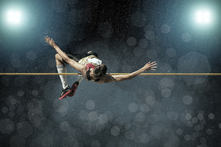 Photo for Athlete in action of high jump. - Royalty Free Image