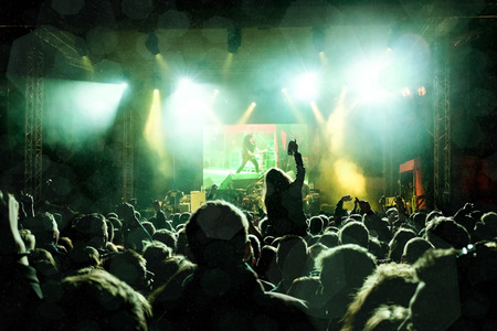 Photo for Rock concert, silhouettes of happy people raising up hands - Royalty Free Image