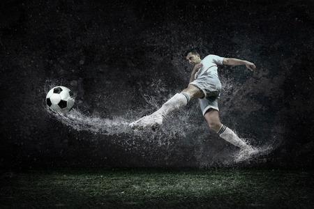 Photo pour Splash of drops around football player under water - image libre de droit