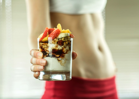 Photo for Desert in the hands of fitness female. - Royalty Free Image