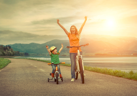 Photo pour Happiness Mother and son on the bicycles funning outdoor - image libre de droit