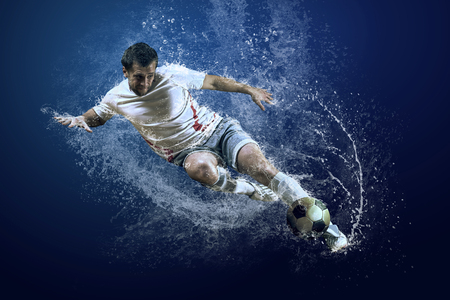Photo for Splash of drops around football player under water - Royalty Free Image