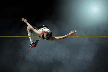 Photo pour Athlete in action of high jump. - image libre de droit