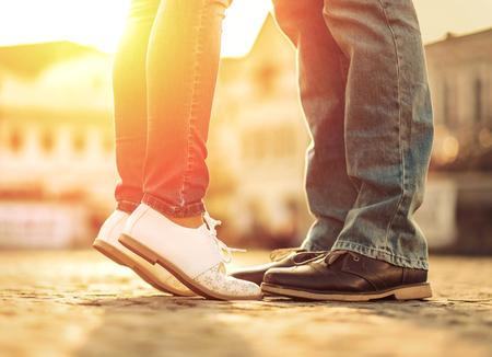 Photo pour Couples foots stay at the street under sunlight - image libre de droit
