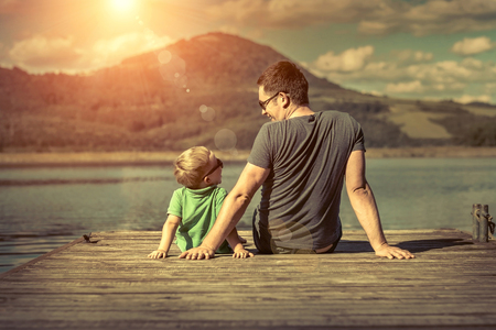 Photo for Happiness father and son on the pier at sunny day under sunlight. - Royalty Free Image
