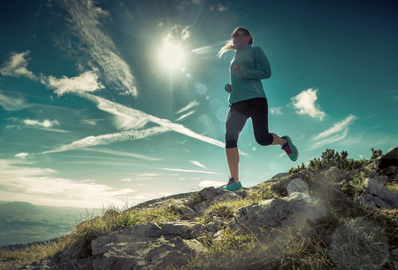 Foto per Female running in mountains under sunlight. - Immagine Royalty Free