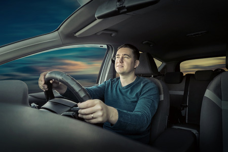 Photo for Man sitting and driving in the car - Royalty Free Image