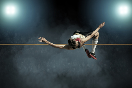 Foto de Athlete in action of high jump. - Imagen libre de derechos