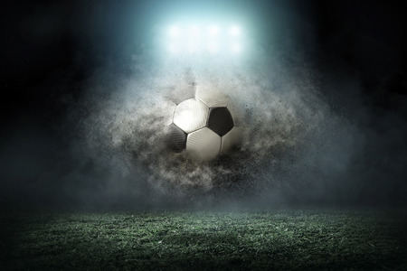 Foto de Soccer player with ball in action outdoors - Imagen libre de derechos