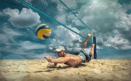 Foto de Beach volleyball player in action at sunny day under blue sky. - Imagen libre de derechos
