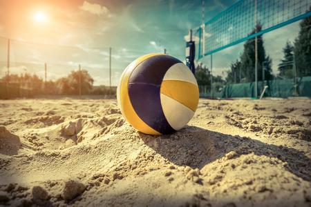 Foto de Beach Volleyball. Game ball under sunlight and blue sky. - Imagen libre de derechos