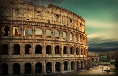 Photo for Roman Coliseum under evening sun light and sunrise sky. - Royalty Free Image