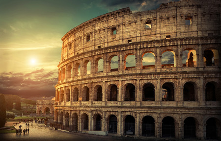 Photo pour Rome, Italy.One of the most popular travel  place in world - Roman Coliseum under evening sun light and sunrise sky. - image libre de droit