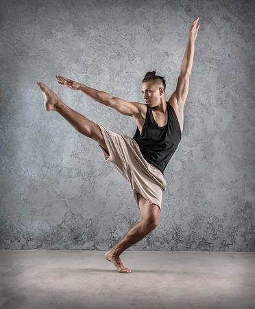 Photo pour Man dancer, in beautiful dynamic jump action figure on the grunge background. - image libre de droit