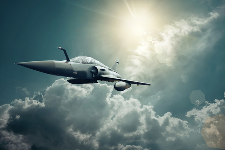 Foto de Military airplan on the speed in the sky - Imagen libre de derechos