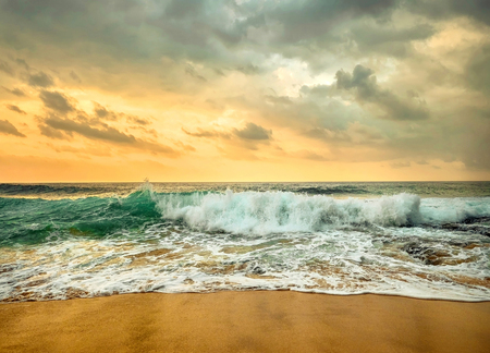 Foto de Beautiful Tropical Sea view under sunset sky at Sri Lankain beach. Stormy waves in evening time. - Imagen libre de derechos