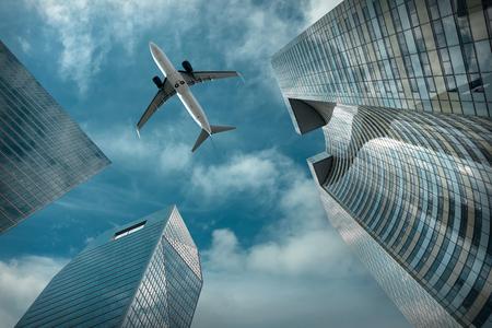 Foto de Airlane flying over modern glass and steel office buildings near La Defence district in Paris, France. - Imagen libre de derechos