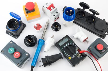 Foto de Electrical equipment and various tools on white background - Imagen libre de derechos