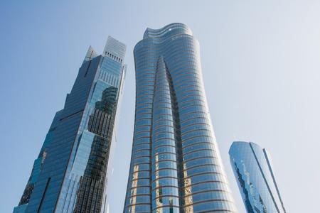 Photo for Qatar International Islamic Bank Headquarters Tower (Qiib) in Qatar. Modern skyscraper with sun highlight on blue sky background, vertical - Royalty Free Image