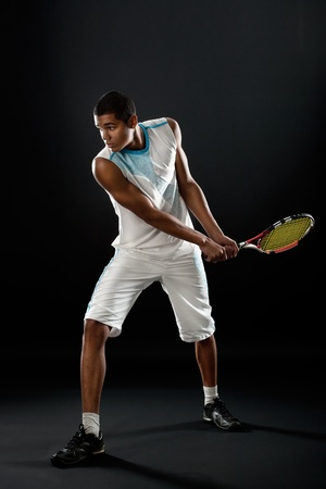 Young tennis player with racket playing tennis