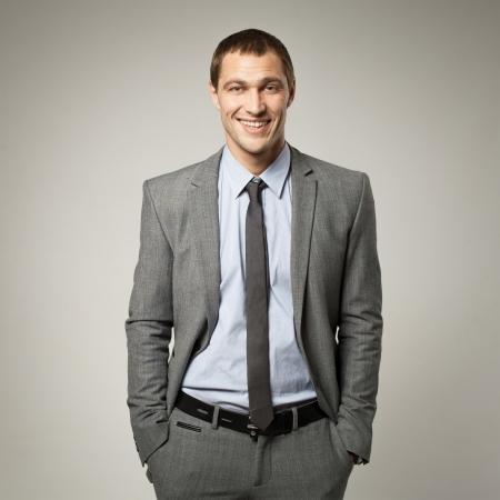 Photo pour Cool businessman portrait on grey background - image libre de droit