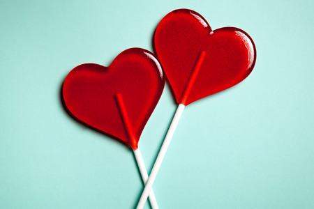 Foto de Two lollipops. Red hearts. Candy. Love concept. Valentine day. - Imagen libre de derechos