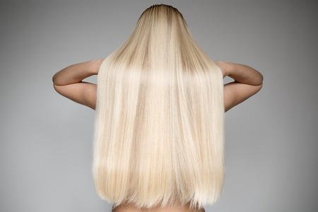 Photo pour Portrait Of A Beautiful Young Blond Woman With Long Straight Hair. Back View - image libre de droit
