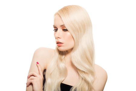 Photo pour Portrait Of Beautiful Young Blond Woman With Long Wavy Hair. Isolated. - image libre de droit