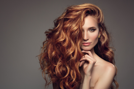 Photo for Portrait of woman with long curly beautiful ginger hair. - Royalty Free Image