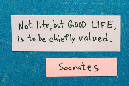 famous ancient Greek philosopher Socrates quote interpretation with sticky notes on vintage carton board about better life