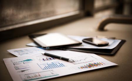 Foto de business documents with charts growth, keyboard and pen. workplace businessman - Imagen libre de derechos