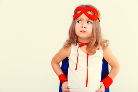 Foto de Funny little power super hero child (girl) in a blue raincoat - Imagen libre de derechos