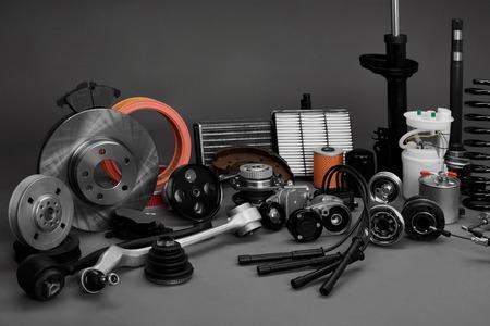 Foto de New car wheels and filters on a gray background. Parts closeup on a gray background - Imagen libre de derechos