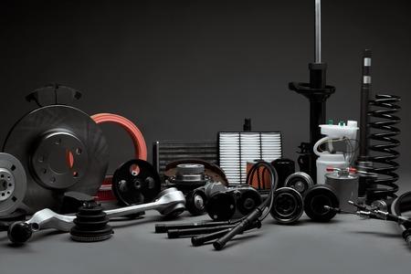 Foto de New car parts on a gray background closeup. Shop for auto - Imagen libre de derechos