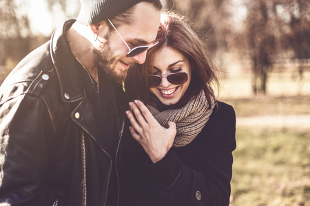 Foto de portrait of young beautiful stylish couple  in autumn park - Imagen libre de derechos