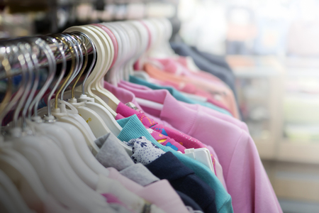 Photo for clothes hanging on a hanger in a store - Royalty Free Image