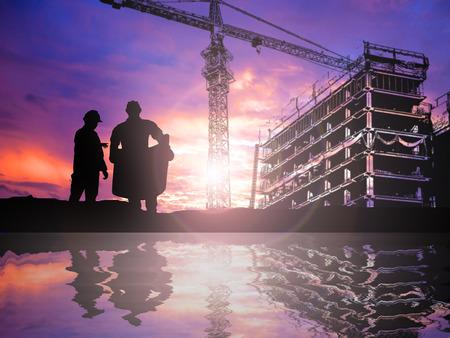 Foto de silhouetteengineer working  in a building site over Blurred construction worker on construction site - Imagen libre de derechos