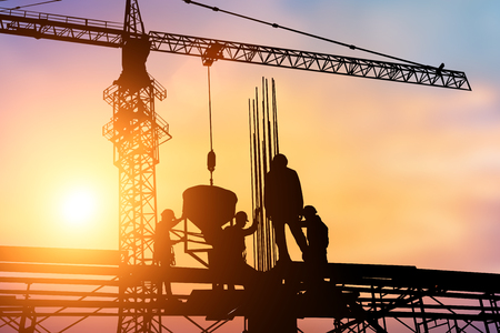 Photo pour Construction workers and engineers working on high security near the tower crane. Heavy industry and Safety at Work concept. - image libre de droit