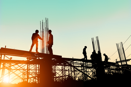 Photo for Silhouette engineer standing orders for construction crews to work safely on high ground over blurred natural background sunset pastel. heavy industry and safety at work concept. - Royalty Free Image