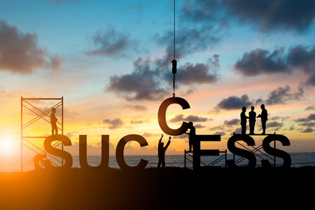 Foto de Silhouette's employees work as a team to work out successfully over blurred sky at sunset. Teamwork, success, Industry, Business, People, engineers, working in a systematic, concept. - Imagen libre de derechos