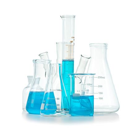 Foto de Test-tubes, flasks with blue liquid isolated on white - Imagen libre de derechos