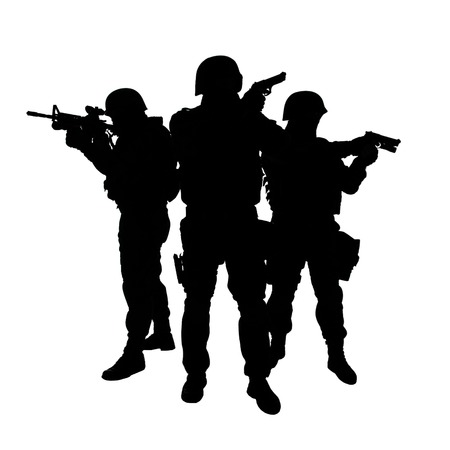 Foto de Silhouettes of special weapons and tactics SWAT team in action - Imagen libre de derechos